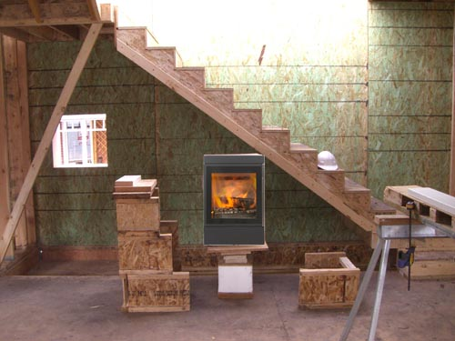 The Rais stove photoshopped in to the staircase wall