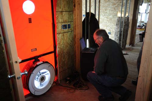 Mike Mcpherson runs our blower door test
