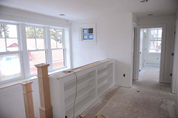 The windows are in and painted; the bookshelf is painted; we're getting there!